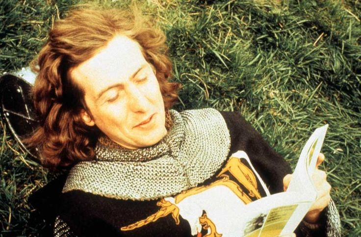 Eric Idle taking a break and reading a book on the set of Monty Python and the Holy Grail