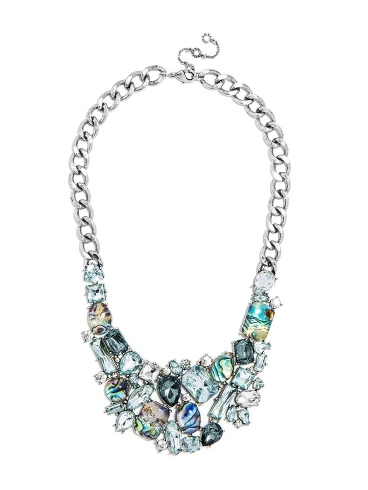 "A luxe, clustered crystal bib interspersed with iridescent abalone accents is a mermaid princess-worthy statement. Necklace has lobster closure and length of 16"" with 2"" drop and 2"" extension. Each stone is unique so shape, color and size may vary."