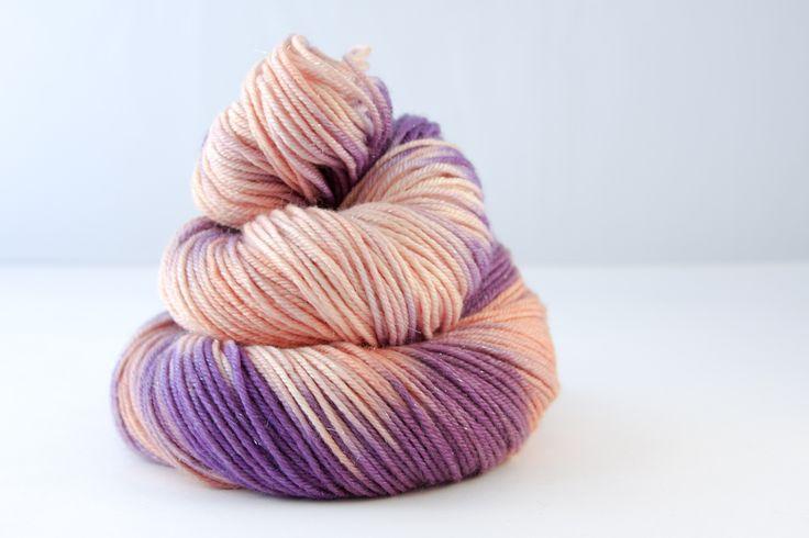 Sutherland DK  75% Fine superwash Merino, 20% silk, 5% silver Stellina  Double Knit, 100g skeins, 211 metres per 100g.  Colour - variegated orange, peach, aubergine  Hand wash recommended, dry flat