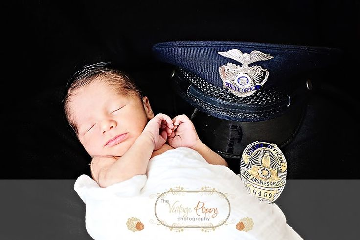 sweet baby picture idea newborn with daddy's policeman hat