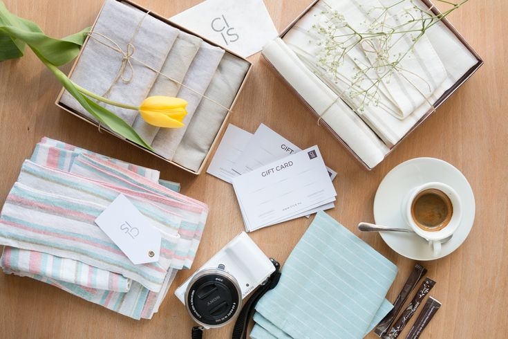 Flatlay with linen napkin packages & our Sony Alpha 5000 camera