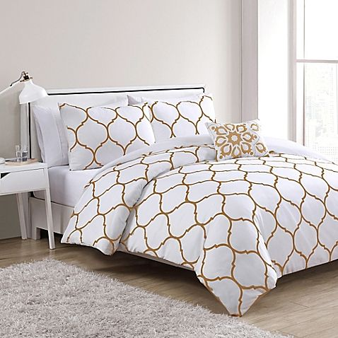 Bring chic style into your bedroom with the Ogee Duvet Cover Set from VCNY. In aqua white, the set brings understated elegance to your space with a large gold embroidered Moroccan pattern, complete with pillow sham and decorative throw pillow.
