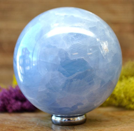 Blue Calcite Polished Crystal Sphere.  ~ Weight: 600 grams ~ Size: 75 mm    To see other crystals cut from the same stone follow this link: https://www.etsy.com/shop/auramore/search?search_query=blue+calcite  To see other spheres - follow this link: https://www.etsy.com/shop/auramore/search?search_query=sphere  Tips when navigating our store: Go to our shop auramore.etsy.com. Use the Search Bar to type in keywords such as: Angel, Sph...