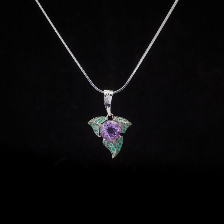 """Pendant """"Shamrock""""  Material: 585 white gold, amethyst, emeralds"""