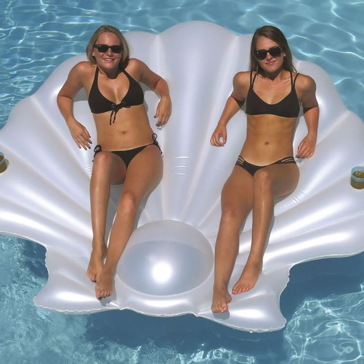 Kick off your seashell collection with this Swimline Giant Inflatable SeaShell Island Lounger Pool Float.