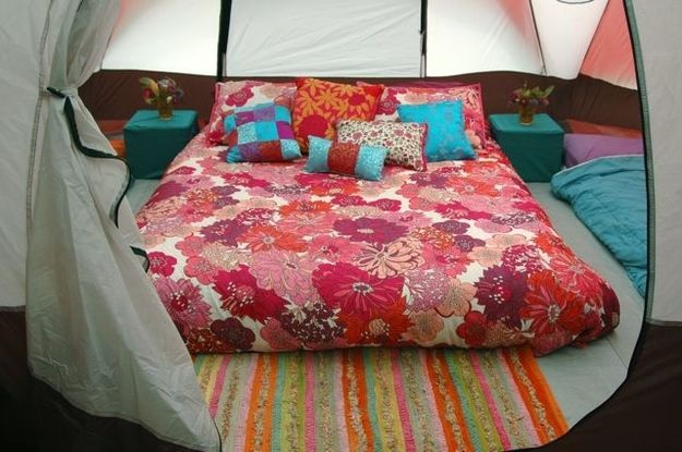 Camping Hacks - make a mattress topper from sleeping bags, blankets or memory foam, then add a fitted sheet to keep it on top.