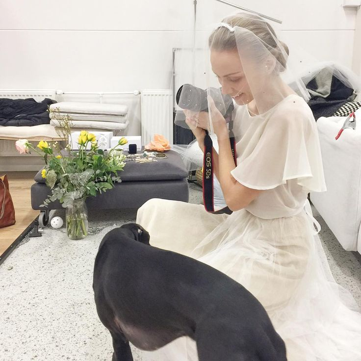 Urban wedding style and having fun with a dog friend. Heili Bridal Instagram  @emmijemilia taking pictures with our office dog Charlie
