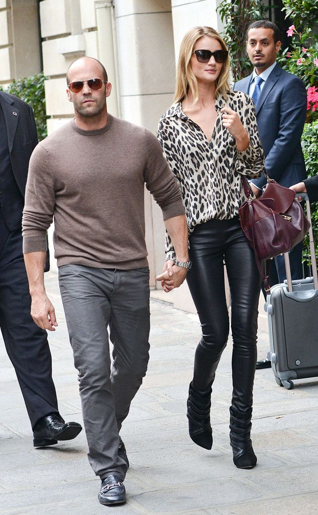 Rosie Huntington-Whiteley.. black skin-tight leather trousers, leopard-print blouse, and leather handbag.. complete with Isabel Marant Tacy Pony Booties..
