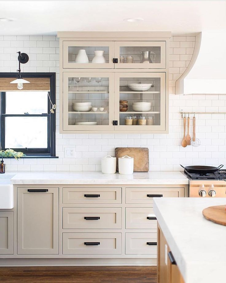 Putty Tan Colored Kitchen Cabinets With White Subway Tile Backsplash And Black Windows Beige Kitchen Kitchen Interior Kitchen Inspirations