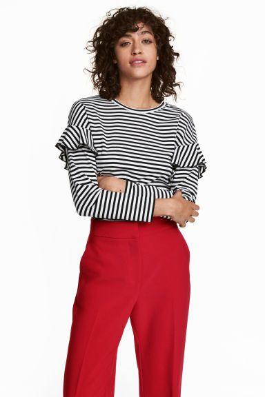 Jerseytop med flæser - Sort/Hvidstribet - Ladies | H&M DK 1