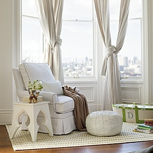 love the white, the drapes, the side table and Especially the white leather pouf ottoman!!