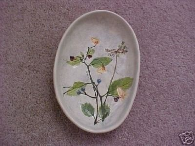 SALT MARSH HANGING BOWL This auction is for a 7 1/2  by 5 1/4  Salt Marsh Pottery Hanging Bowl. Signed on the back and the flower is Viburnum Jewelweed. Excellent condition, no chips or cracks.
