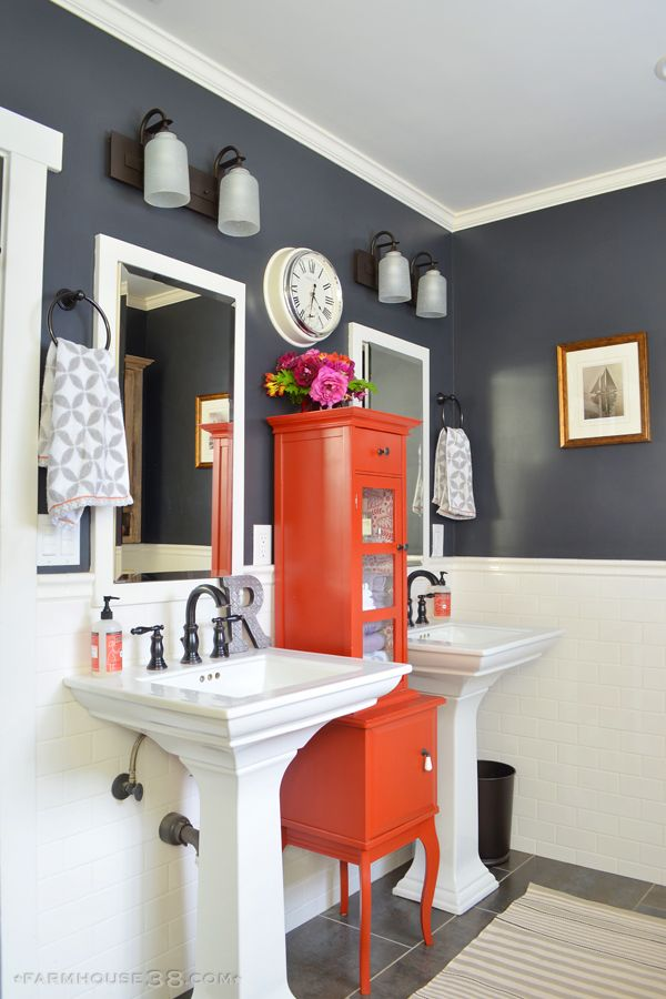 Colorful master bathroom - love the dark paint paired with lots of white and a fun pop of color with the red cabinet eclecticallyvintage.com