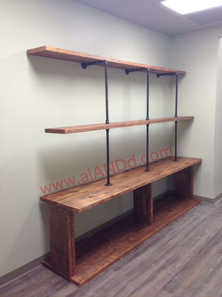 Custom made wood and pipe shelving unit by Erick Lopez of Art Illusions & Designs.    www.aiANDd.com