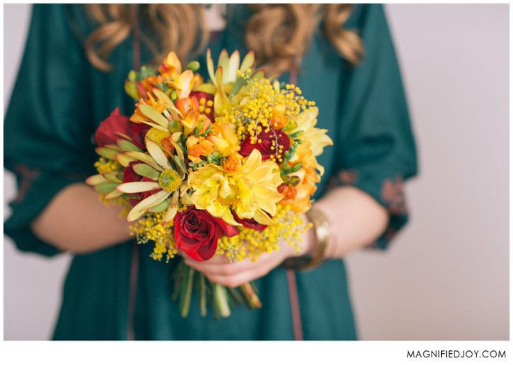 Snowy Indian Fusion Stylized Photo Shoot | Bright bouquet of mimosa acacia, leucedendron, roses, freesia, and dahlias in yellow and red | Bouquet by Alluring Blooms | Photo by Magnified Joy - Madison, WI Wedding Photographer