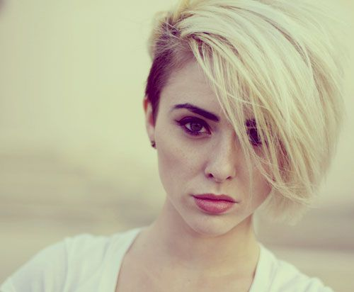 Undercut Hair Designs | Short pixie haircut with highlights of multi-colored tones gives a ...