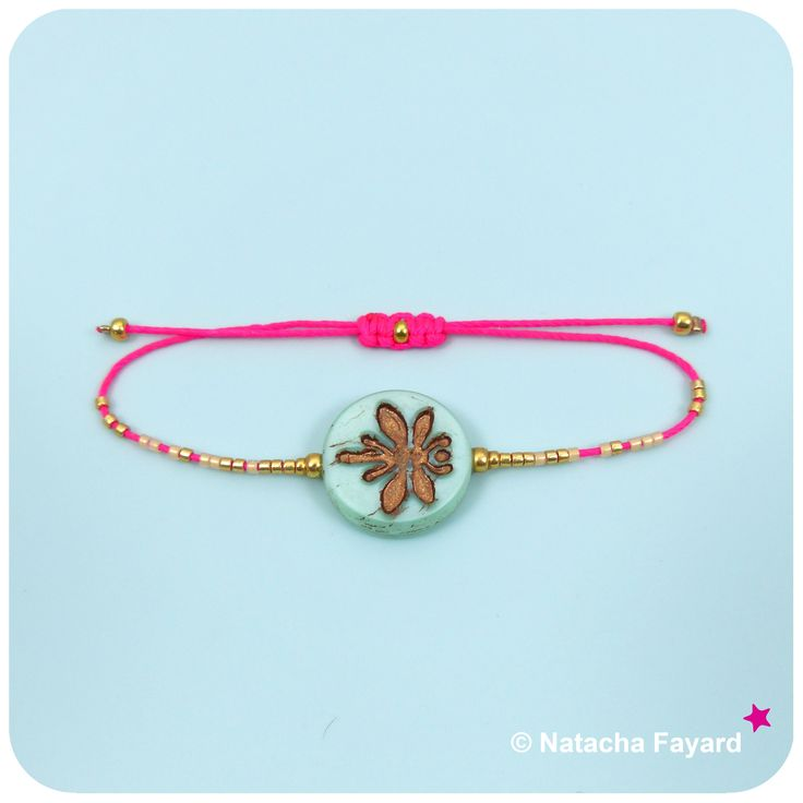 Friendship bracelet with neon pink thread, mint green dragonfly bead and gold miyuki delica seed beads.  © Natacha Fayard  #mint #green #neon #pink #gold #friendship #bracelet #dragonfly #SS2017