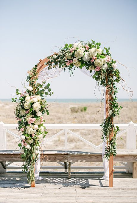 Brides.com: 30 Amazing Ceremony Structures A classic, floral-covered wedding arch, created by Teresa Gausman of Premiere Events.Photo: Britt Croft Photography