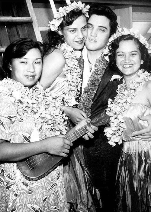 Elvis Presley aboard the Matsonia with hula dancers, November 9, 1957.