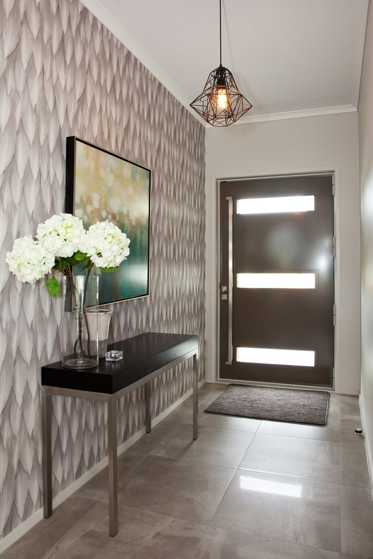 A modern funky light fitting for the entrance to this new Rodney Show home.