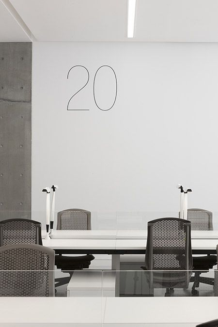 Studio workspace numbers are screened directly on the walls.