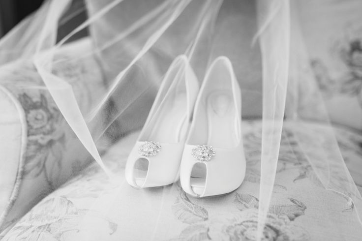 Beautiful bridal shoes from Pink Paradox with veil. Photo by Benjamin Stuart Photography #weddingphotography #pinkparadox #bridalshoes #wedding #bride