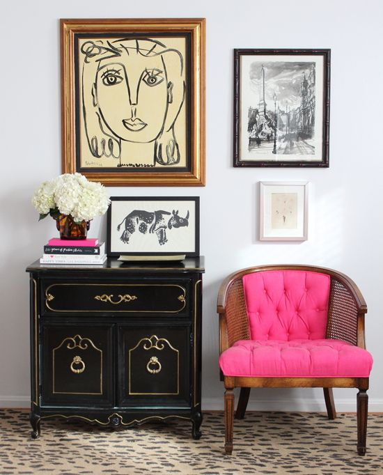 For some reason I automatically imagine this vignette with its hot pink accent chair to come from a chic Parisienne apartment - or maybe New York?! The controlled burst of colour works so well without being overpowering