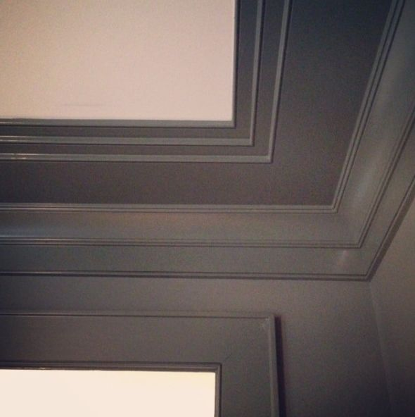 Moulding Detail. Good for a basement it visually raises to height of the ceiling