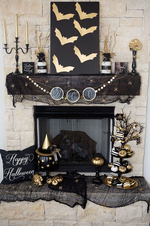 What's black and white and metallic all over? This Halloween mantel goes glam for the holidays, without sacrificing the overall sophisticated aesthetic of your living room.