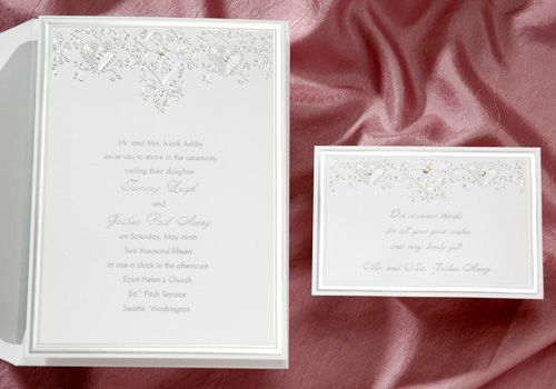 Item T9742   price per 100: $179.90   The classic silver foil stamping on this invitation is exquisite! The center elements are embossed to look like rhinestones.