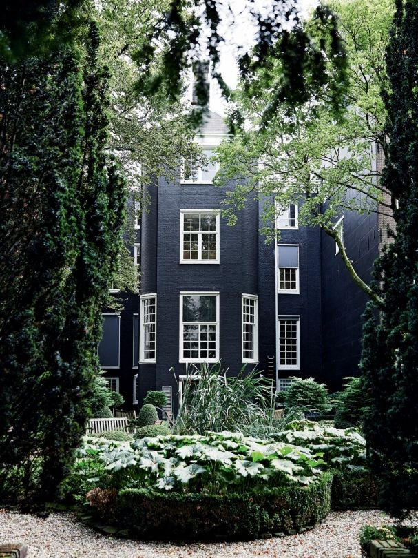 House - dark exterior with green all around - match for the couch color!