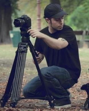 Love this photo of Emre Aydın with a camera.
