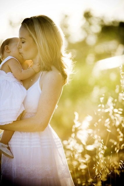Love everything about this. Captures a mother's love in a timeless moment. Beautiful.