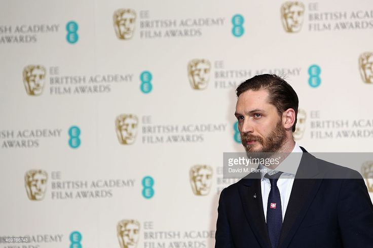 Actor Tom Hardy poses in the winners room at the EE British Academy Film Awards 2014 at The Royal Opera House on February 16, 2014 in London, England.