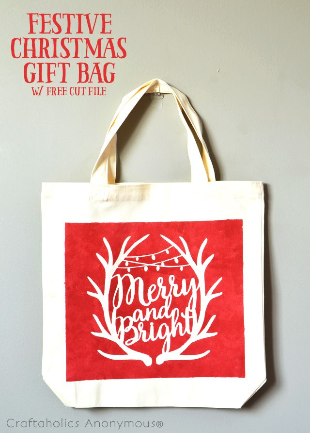 Download this free cut file and make this festive DIY Christmas Gift Bag, perfect for toting all your Christmas gifts around this season!