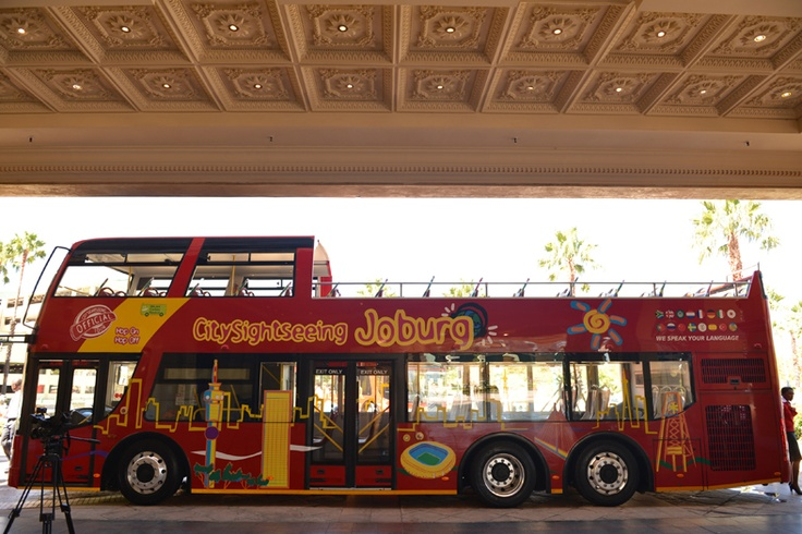 The City Sightseeing Bus look very majectsic outside the Gold Reef City Hotel Tour Office.