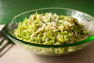 Shaved Brussels Sprouts Salad Recipe. Sprouts with hard boiled eggs and pine nuts with dijon dresing.