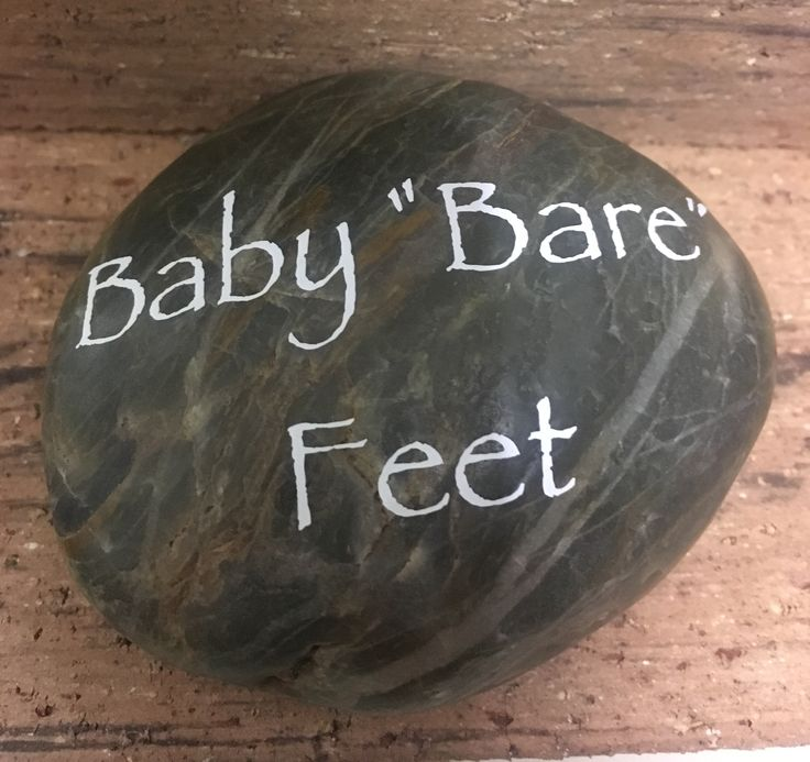 River stones were used for displaying the names of the appetizers for the woodland-themed baby shower