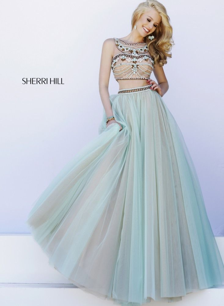 SHERRI HILL Prom Dresses 2015 # 11271 A generous mix of nude, ivory and pastel stones are expertly fitted to the nude lace bodice on this unique two-piece dress. Matching beadwork trims the multiple layers of a tulle ball gown skirt.