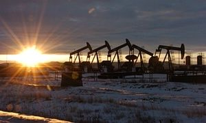 """Oil falls by $2 a barrel with energy shares as Opec (our """"Buddies' """") refusal to stop flooding the market with cheap oil & likely US rate hike sends Brent crude tumbling. Signs of disarray in the Opec oil cartel prompted fears of a global glut of oil, wiping $2 off the price of a barrel of crude on Monday and leading to speculation that energy costs could continue tumbling over the coming weeks. (Photo - Oil rigs in western North Dakota, US)"""
