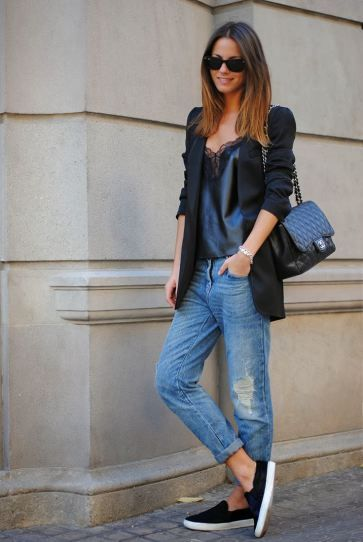 25 Ways to Style Baggy Jeans All Winter Long - delicate black satin camisole + long blazer worn with baggy jeans, a Chanel bag + comfy slip on shoes