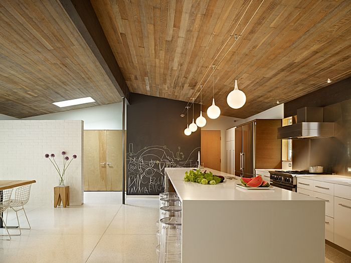 "Lakewood Mid-Century Modern. Remodel opened up walls, updated finishes, and created a family kitchen centered around ""the mother of all islands."" Photo: Benjamin Benshneider"