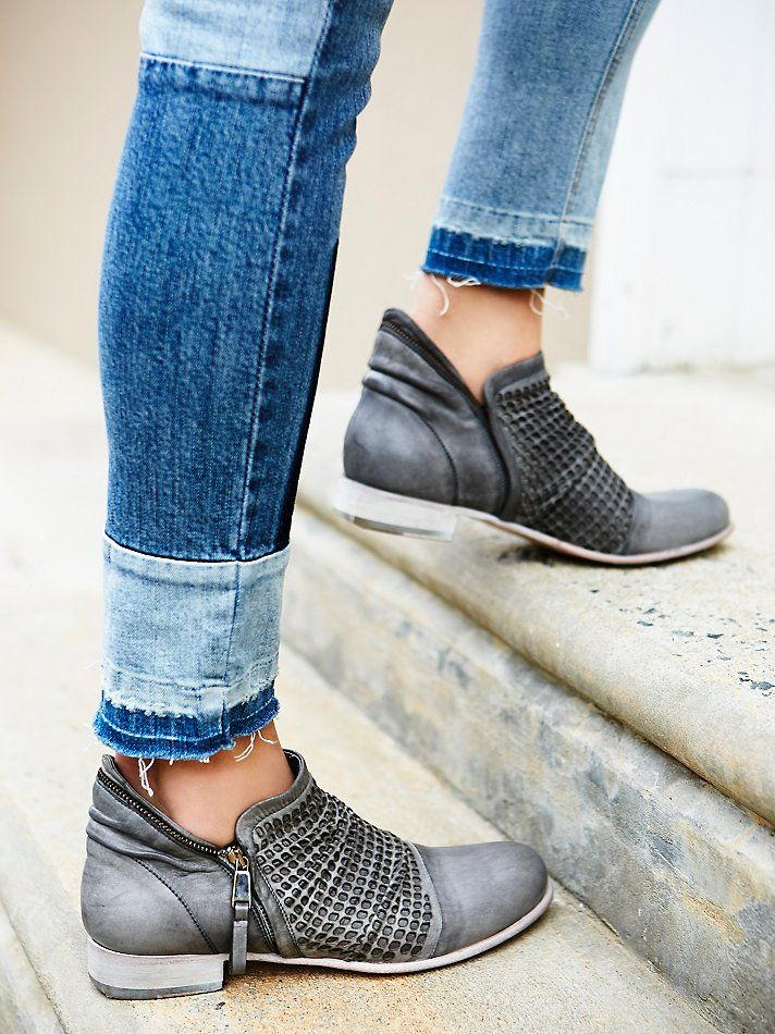 End Of A Dream Ankle Boot | Made in Italy, these leather ankle boots feature a distressed finish for a worn-in aesthetic. Woven textured upper and rounded toe. Exposed outer zip for an easy on/off. Stacked heel.