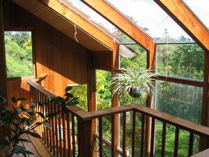 Two Story Greenhouse In A Straw Bale Home With Passive Solar