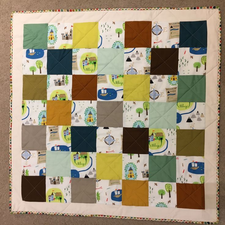 Attempt at a Game of Thrones baby quilt for a boy, mixing up scenery fabric with colour blocks