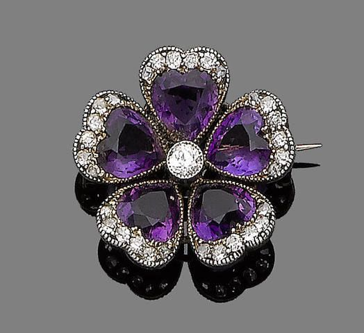 An amethyst and diamond-set pansy brooch, circa 1890. Each petal millegrain-set with a heart-shaped amethyst and highlighted by old brilliant and rose-cut diamonds, centrally set with a collet-set old brilliant-cut diamond