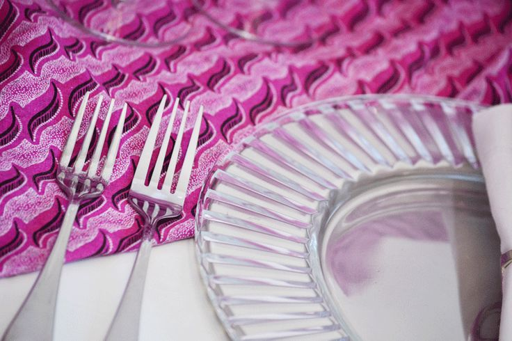 Modern pewter cutlery paired with bold pink shweshwe. Hire these items from our collection using the link below.