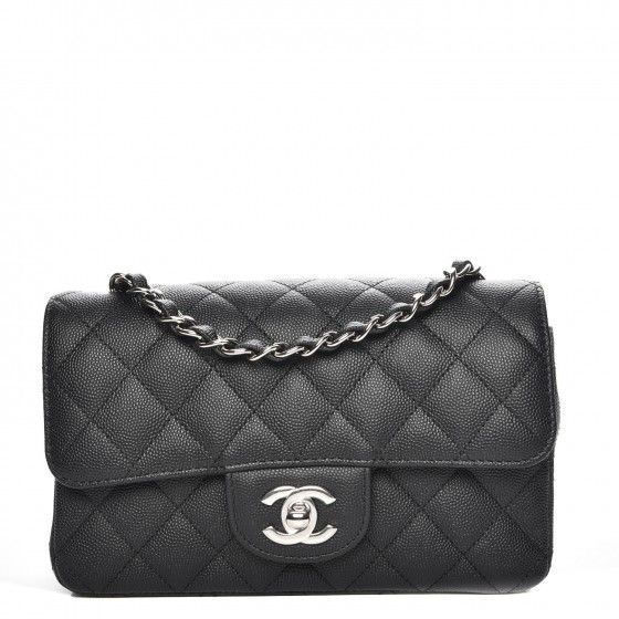 This is an authentic CHANEL Caviar Quilted Mini Rectangular Flap in Black. This chic petite shoulder bag is crafted of diamond quilted luxurious caviar leather in black. The bag features a long silver chain link leather threaded shoulder strap and front flap with a silver Chanel CC turn lock. The flap opens to a smooth leather interior with a zipper and patchpocket. Enjoy this fabulous bag for everyday essentials or special events with the timeless quality ofChanel.