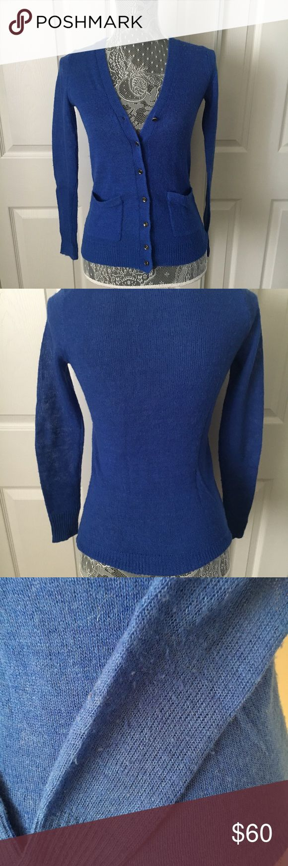 """JCrew Royal Blue alpaca blend cardigan Size XXS Has stretch to it, Measures approx 23"""" in length and 17"""" flat from armpit to armpit Waist is approx 14"""" flat Has some pilling throughout and 2 runs/pulls in the fabric on the left arm- please refer to last photos Overall very nice condition 45% acrylic 37% superfine alpaca 18% merino wool J Crew Sweaters Cardigans"""