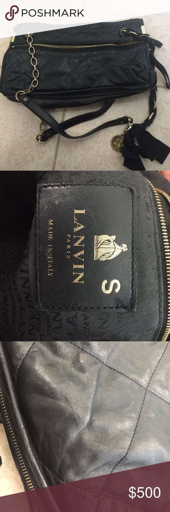 """Lanvin Sample Black Quilted Leather Amalia Md used Amalia Medium Shoulder Bag- used. Genuine, from Lanvin, but was a sample used for the Neiman Marcus online photographs only, purchased at a sample sale. This is noted with the """"s"""" on the inside tag. Quilted lamb skin. The hang tag is worn and I untied some of the black ribbon woven in the straps. Gold tone hardware that has somewhat rubbed off on the straps from my use so it looks gold/silvery. Small scuffs. Ink stain on back in pics. Top…"""